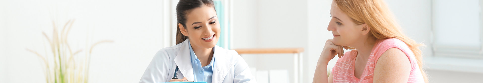 female doctor and her patient talking